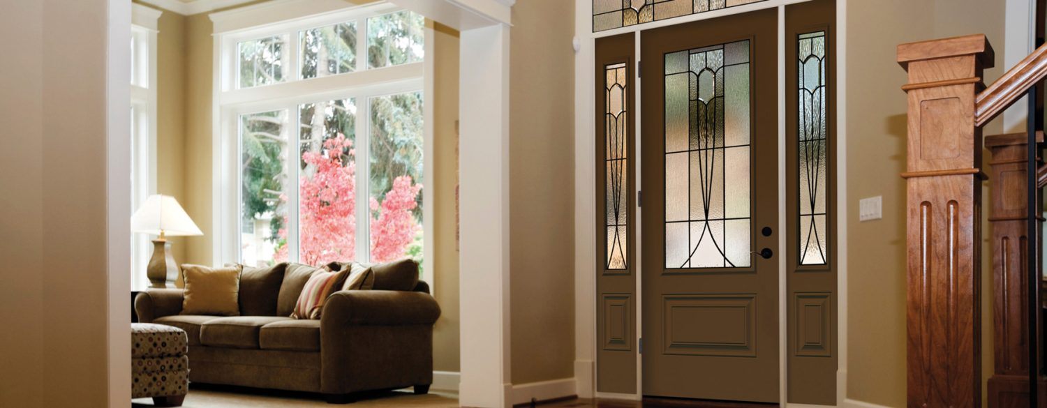 Global Windows & Doors: Entryway and living room using windows and doors from Global Windows & Doors